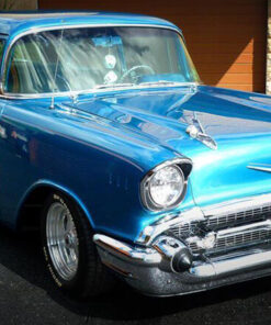 Blue Chevrolet Bad Boy car parked in driveway