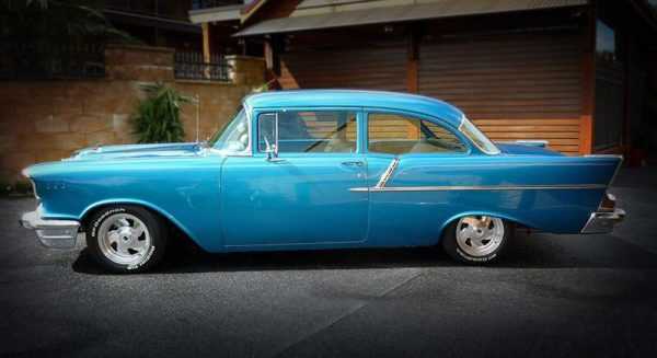 Blue Chevrolet Bel Air Bad Boy car parked in driveway for sale in Brisbane