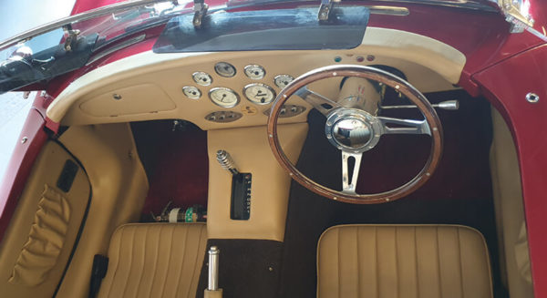 aerial view of leather seats and stearing wheel of ac cobra