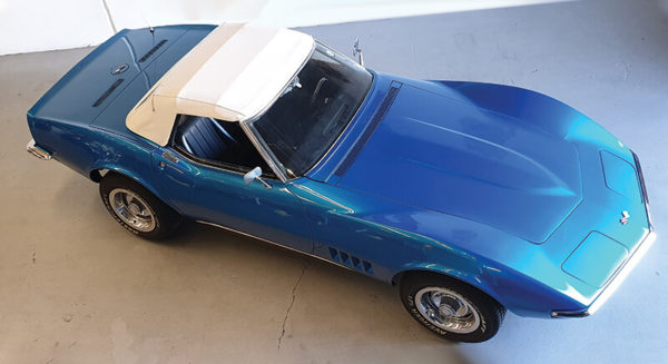 Aerial view of convertible blue 1968 Corvette Stingray car with roof on