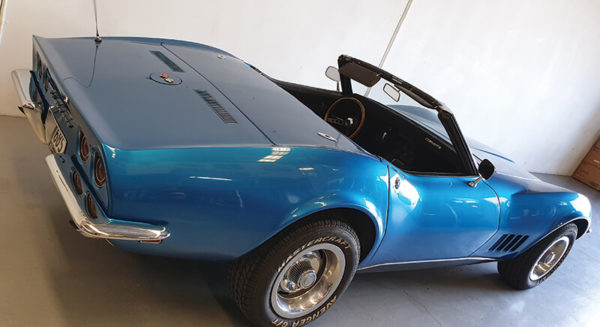 Rear view of convertible blue 1968 Corvette Stingray